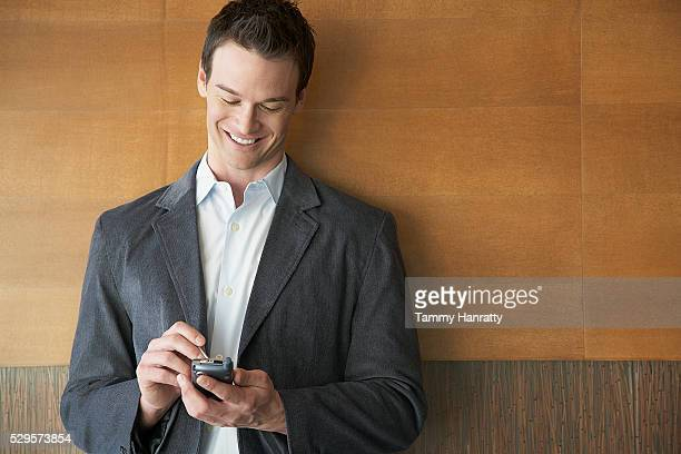 businessman using pda - gray blazer stock pictures, royalty-free photos & images