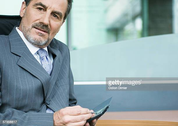 businessman using pda - out of frame stock pictures, royalty-free photos & images