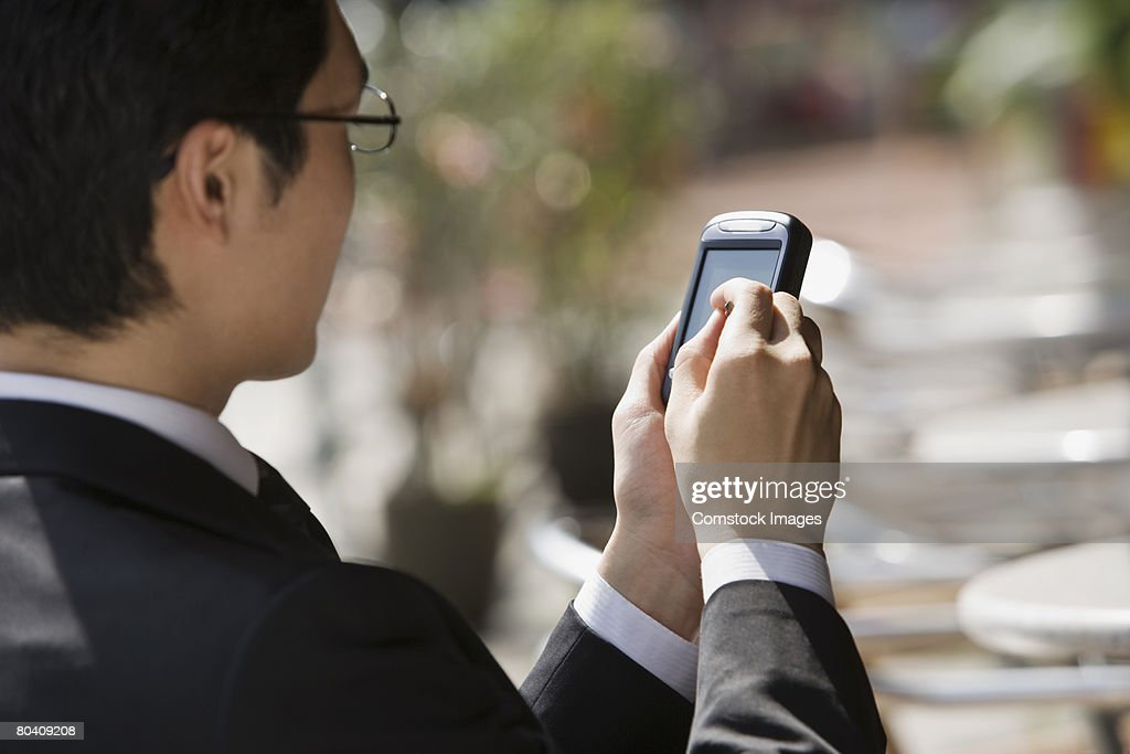 Businessman using PDA : Bildbanksbilder