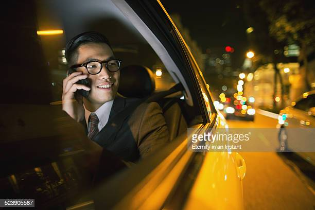 Businessman using phone in car
