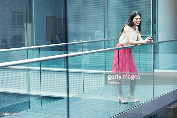 businessman using phone - railings stock pictures, royalty-free photos & images