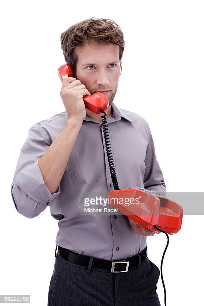 Businessman using phone, portrait, close-up