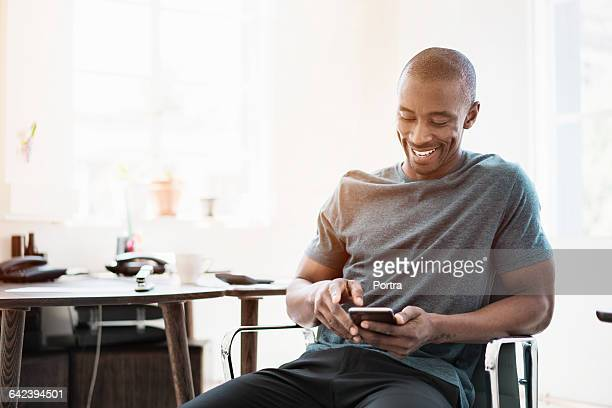 Businessman using phone while sitting on chair