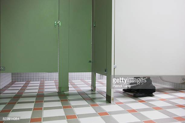 Businessman using public bathroom