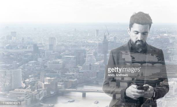 Businessman using smart phone in the city
