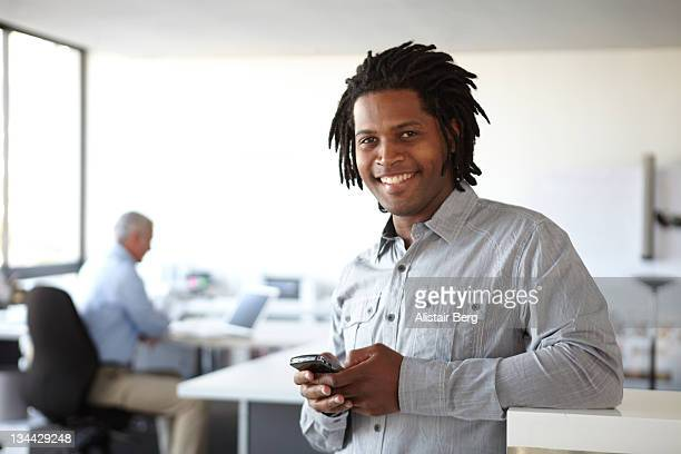 businessman using smart phone - dreadlocks stock pictures, royalty-free photos & images