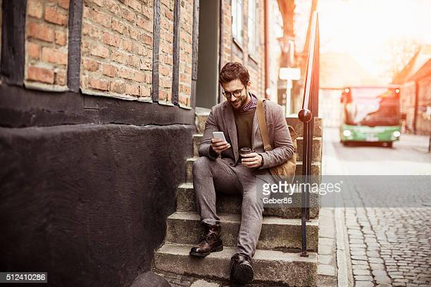 businessman using smart phone - transportation building type of building stock photos and pictures