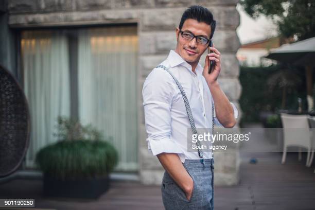 businessman using smart phone - handsome chinese men stock pictures, royalty-free photos & images