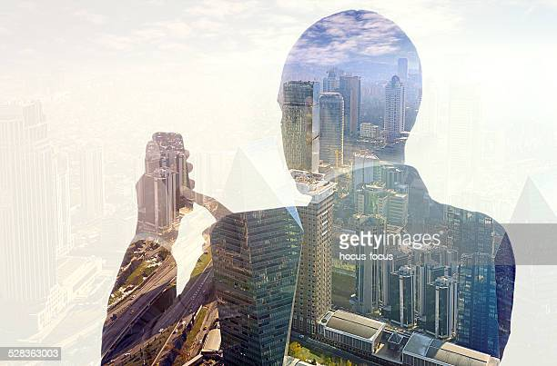 Businessman using smartphone double exposure