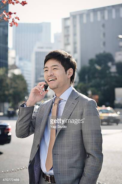 Businessman using Smartphone in city