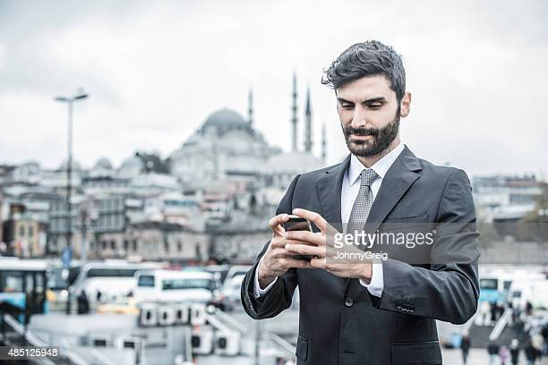 Businessman using smartphone in Middle East