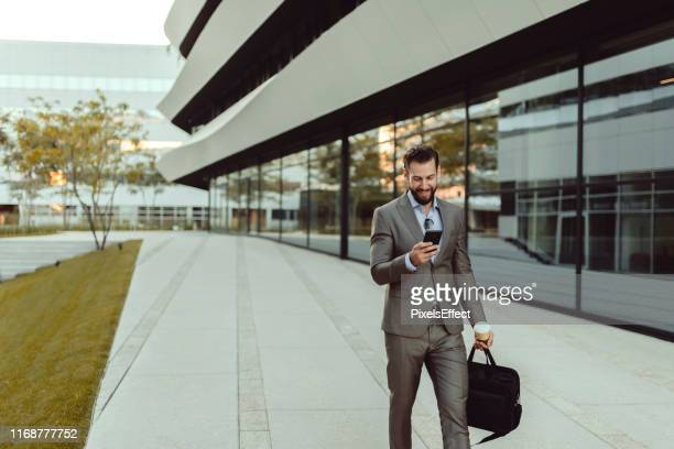 businessman using smartphone - building exterior stock pictures, royalty-free photos & images