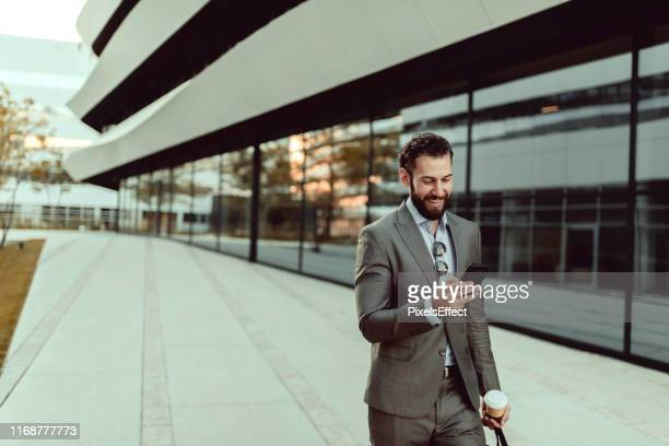 businessman using smartphone - full suit stock pictures, royalty-free photos & images
