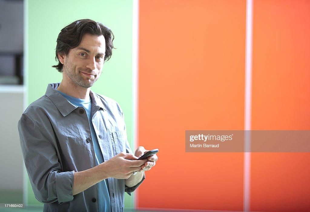 Businessman using smartphone : Stock Photo