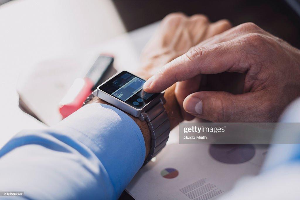 Businessman using smartwatch. : Photo