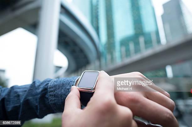 Businessman using smartwatch.