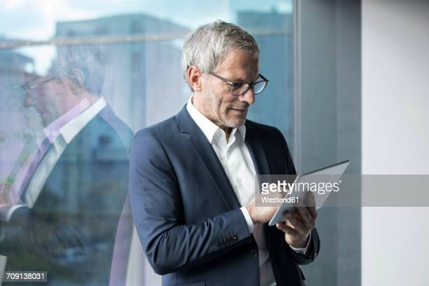 Businessman using tablet at the window