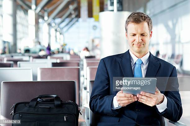 Businessman Using Tablet Computer At The Airport.