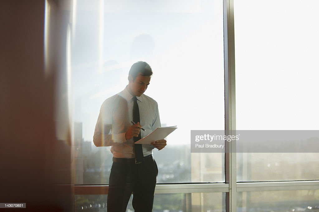 Businessman using tablet computer in office : Stock Photo
