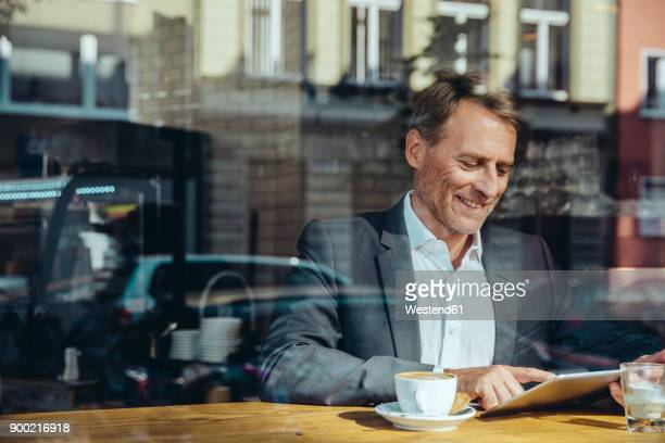 Businessman using tablet in cafe