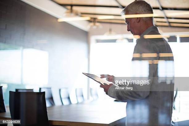 Businessman using tablet in conference room