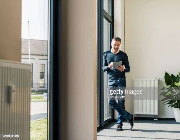 Businessman using tablet in his office