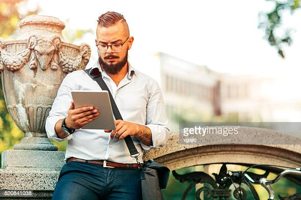 Businessman Using Tablet Outdoors.