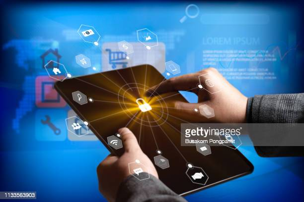 Businessman using tablet with virtual icon technology. the concept of communication network cyber security internet of things.
