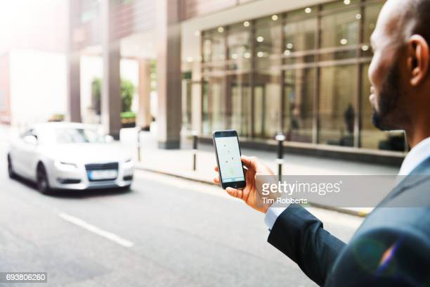 Businessman using taxi app