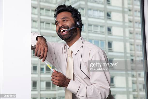 businessman using telephone headset - funny customer service stock pictures, royalty-free photos & images