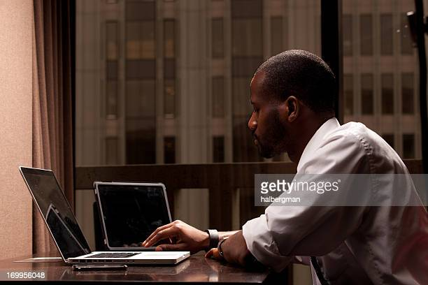 Businessman Using Three Mobile Devices