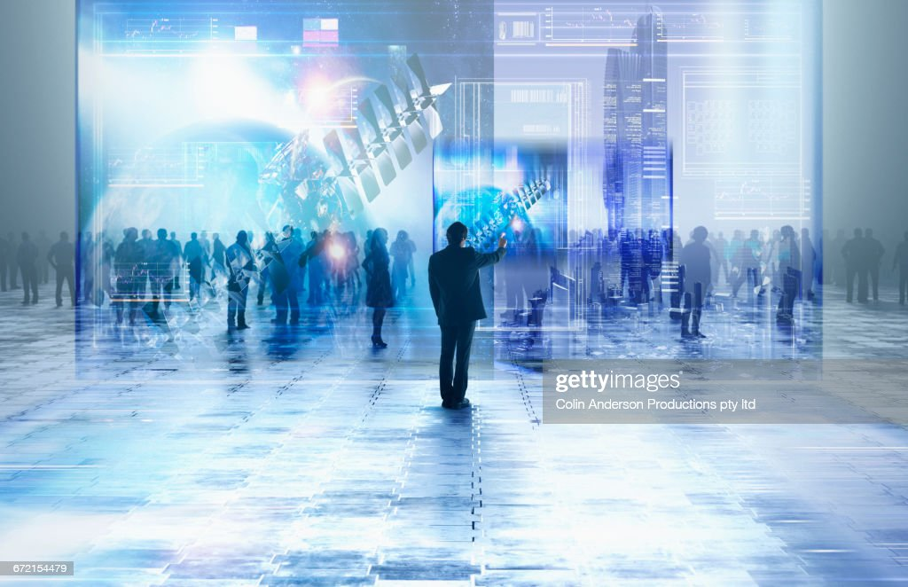 Businessman using virtual visual screen in crowd : Stock Photo