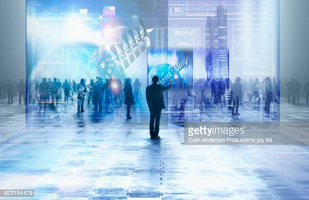 businessman using virtual visual screen in crowd - messen stock-fotos und bilder