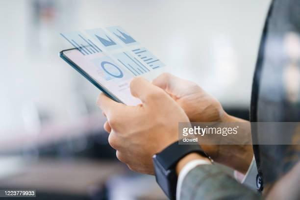 businessman using virtual visual screen - affichage digital photos et images de collection