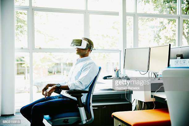 Businessman using VR headset in office