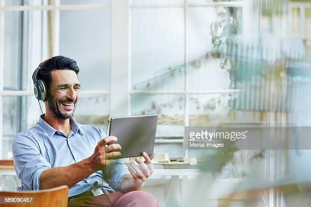 Businessman video conferencing on digital tablet