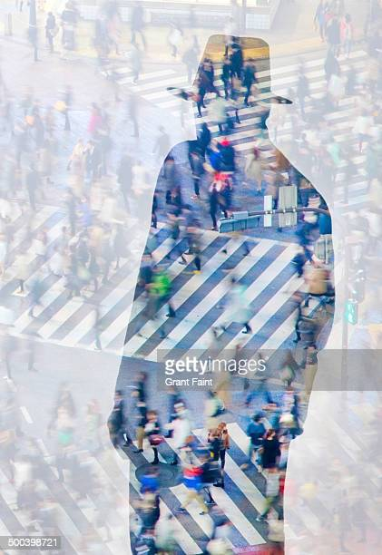 businessman  viewing busy pedestrian crossing - privateinvestigator stock pictures, royalty-free photos & images
