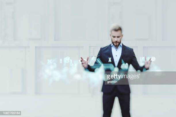 businessman vr interaction - hologram stock pictures, royalty-free photos & images