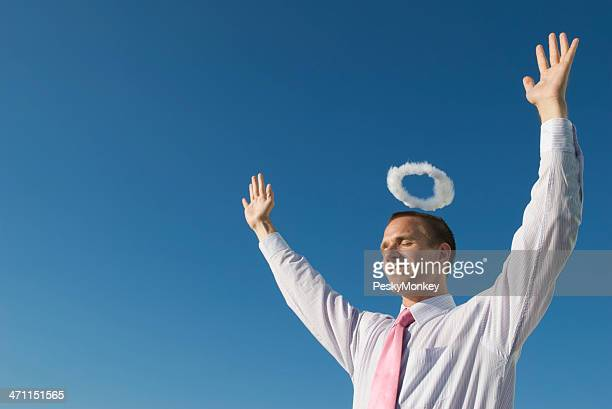 Businessman w Halo Smiles with Arms Raised