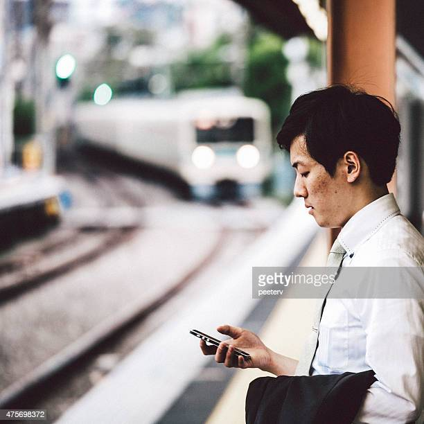Businessman waiting a train in station.