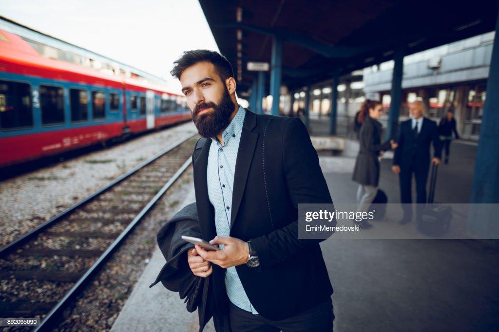 Businessman waiting at train station : Stock Photo
