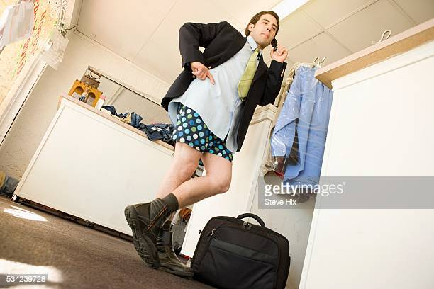 businessman waiting for his pants at a drycleaners - shorts stock pictures, royalty-free photos & images