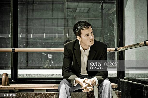 Businessman waiting for the bus.