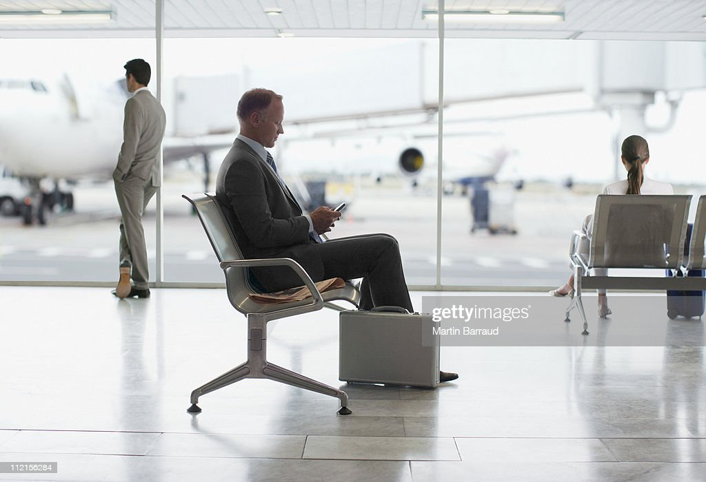 Businessman waiting in airport : Stock Photo