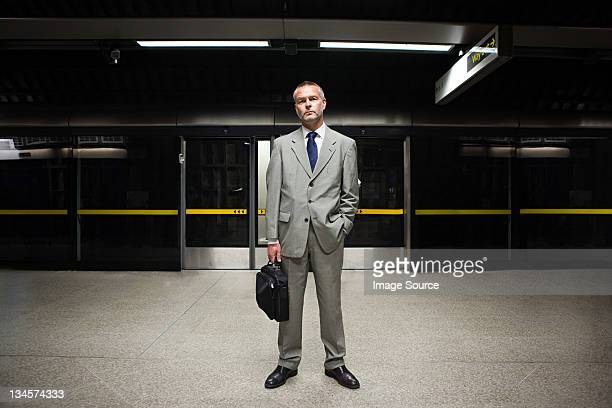 businessman waiting on subway platform - gray suit stock pictures, royalty-free photos & images