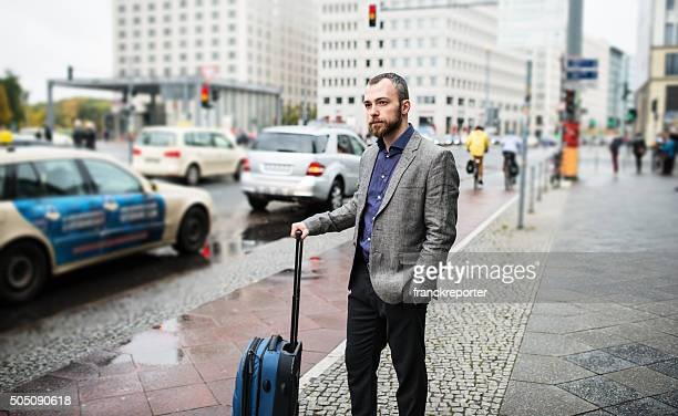 businessman waiting the taxi on the street of berlin