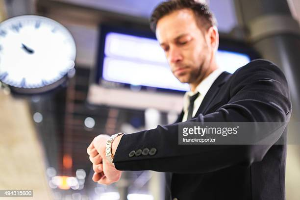 businessman waiting the train at the station - time management stock photos and pictures