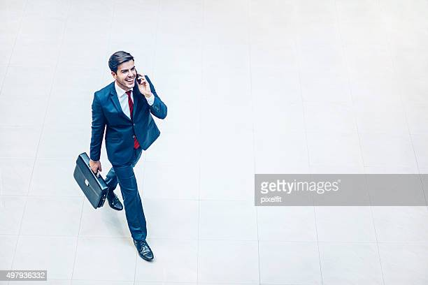 Businessman walking and smiling