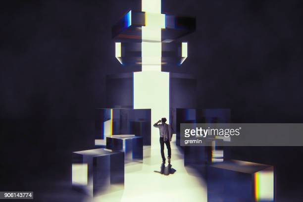 businessman walking between abstract glass cubes - magic doors stock pictures, royalty-free photos & images
