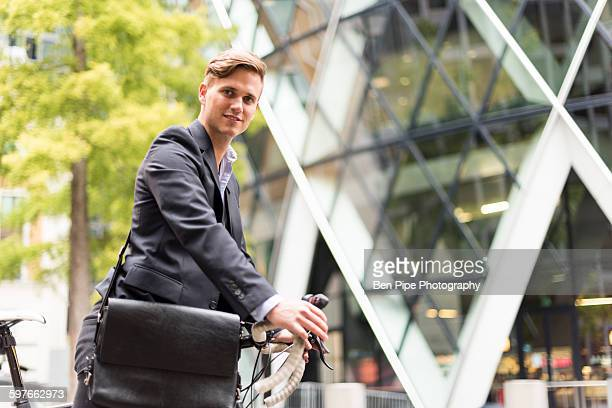 businessman walking bike past 30 st mary axe, london, uk - ben diamond stock pictures, royalty-free photos & images